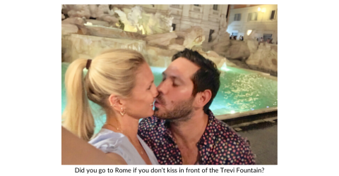 Broad World and boyfriend share a kiss in front of the Trevi Fountain in Rome.